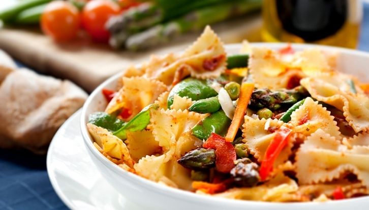 Pasta primavera. Fresh bow-tie pasta with asparagus, beans, peas, snow-peas, tomatoes, carrots and peppers.